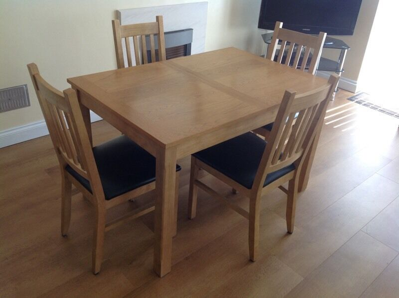 Cucina Oak Finish Dining Table And 4 Chairs