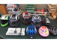 Three motorbike helmets and five bicycle helmets.