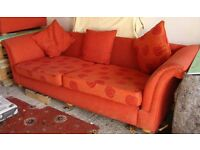 EXTRA LARGE SETTEE IN A RED/ORANGE COLOUR GOOD CONDITION