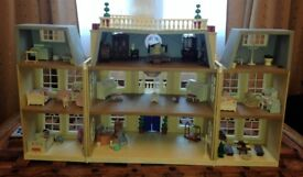 sylvanian families hotel with furniture and figures in used but good condition
