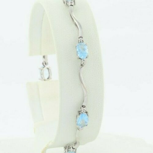 10k White Gold Natural Blue Topaz And Diamond Bracelet 7 1/4 Inch Wavy Design
