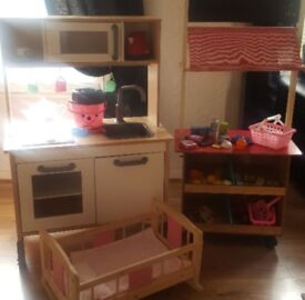 Play kitchen market stall and baby crib