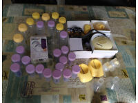 Medela breast pump with extra bits and bottles