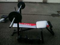 Weight bench with bar and dumbells