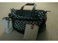 Babymel changing bag. Black & white, with changing mat & bottle holder. Great condition.