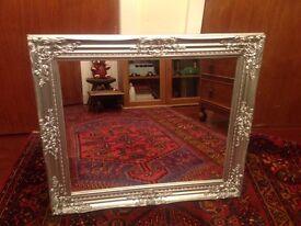 Silver ornate mirror