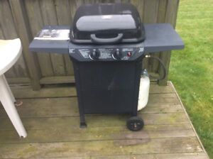 Small backyard grill BBQ with nearly full tank of gas $60.00