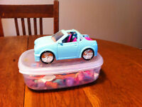 Polly Pocket car and various clothing asssessories