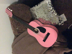 Mini pink guitar in good condition