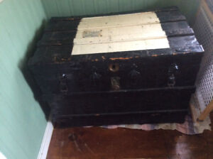 Antique black and white wooden trunk