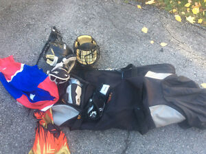 Boys lacrosse bag and some equipment.