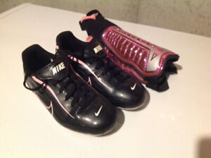 Girls pink Nike soccer cleats size 11 with pink Umbro shin pads