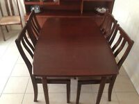 Dining Table and Six matching chairs rose /mid Mahogony colour incl 2 x table protectors