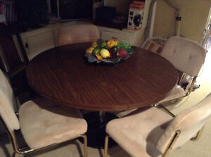 Large round table and 4 chairs.