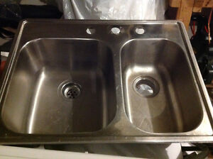 Kitchen double stainless sink.