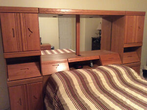 Bed headboard towers and mirror bridge unit