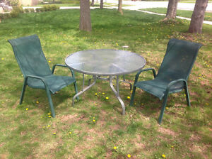 """41.5""""D round patio glass top table- great condition."""