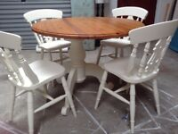 Round table with four matching chairs