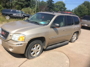 2004 GMC Envoy SLT 4x4 loaded leather selling for parts less rim