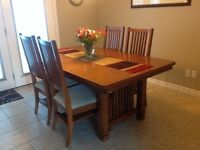 solid wood table with 6 chairs and extra leaf!