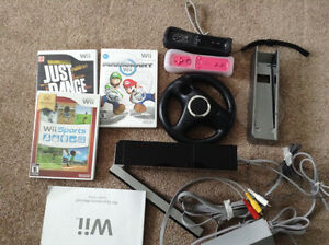 Wii console with two controllers and 3 games