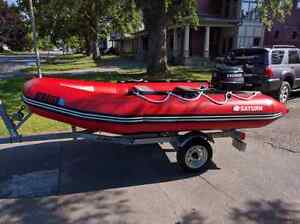 Selling nearly new inflatable boat trailer and 20hp motor