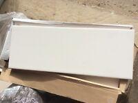 24 white ceramic tiles