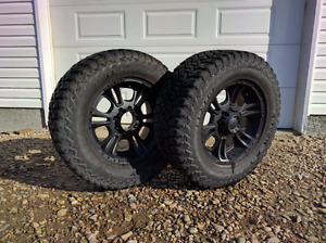 Set of Dunlop Rover M/Ts and wheels