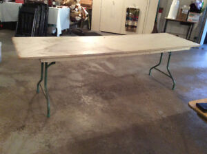 3 Wooden tables complete with folding metal legs $25.00 each