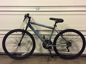"Mountain bike Huffy 18 speed,26"" wheel,new condition"