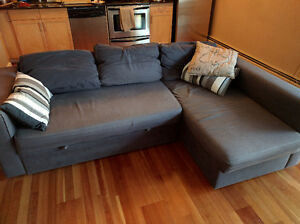 IKEA canvas sectional couch with pull-out