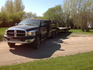 2007 dodge dually with 34' triple axle flat deck trailer