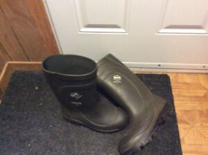 Various pairs of men's boots for sale