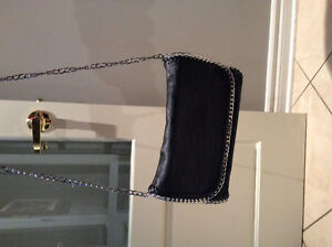 Stylish Blk bag/ silver chain. Cross body. Never used!!! NEW!
