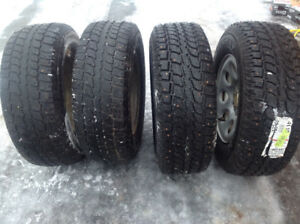 Four  studded Winter Cat tires with rims