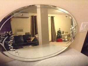 Oval antique mirror