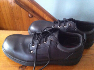 Black leather Steel toe shoes.. size 12 but fit a bit smaller