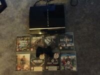 PS3 WITH 8 GAMES £40