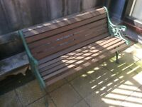 Stylish garden bench with green metal painted decorative ends