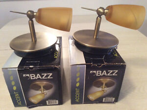 2 Accent Bazz Wall Sconces Amber Lense With Brass Finish Pivots