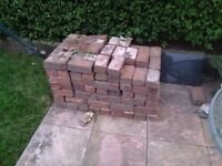 A load of bricks and paving slabs from a garden renovation.