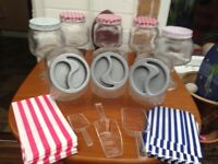 8 x glass sweet jars with scoops and bags