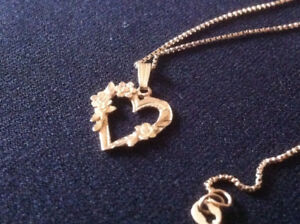 Gold solid necklace. chain 20 inch and pendant