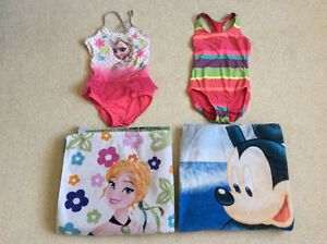7 piece swimming suits, shoes & towels in great condition size 5
