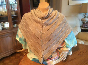 Hank knitted shawls for hospital patients or expecting mothers