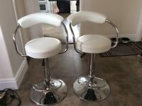 2 white and chome bar stools