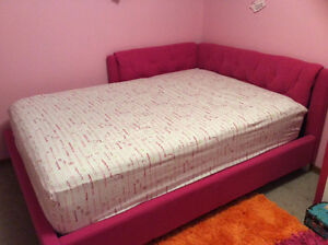Almost New  Padded corner style bed.
