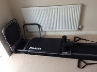 Pilates machine with rebounder, CDs and wall chart