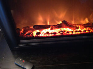 Electric Remote Controlled Log Fireplace/Like New West Island Greater Montréal image 2