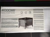 Koochi Travel Cot boxed in excellent condition